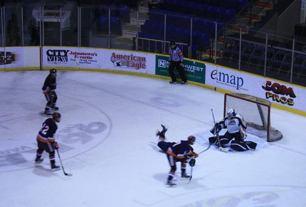Hockey players check, glide, fire toward goals