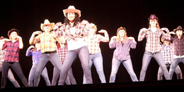 Women dance in ensemble performance
