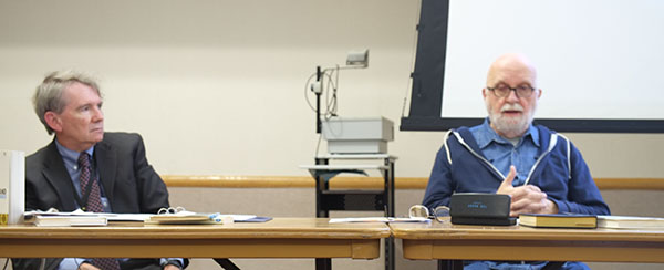 Pitt-Johnstown philosophy professor Martin Rice (left) debates with Duquesne University philosophy professor Fred Seddon (right) on Ayn Rand's theories of ethics and art Friday in the Cambria Room.