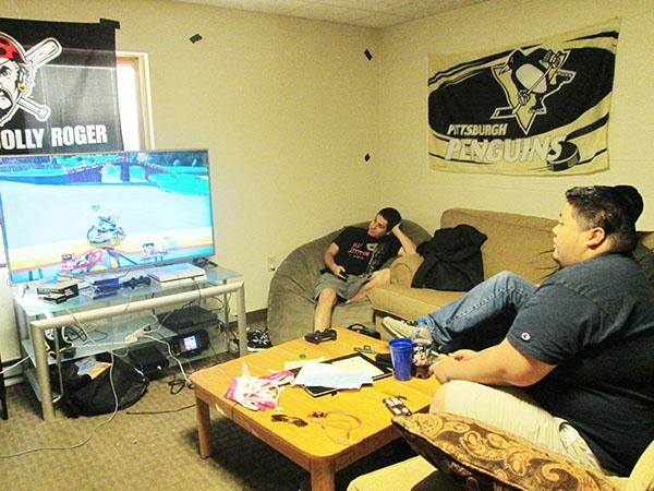 Jared Daskal watches Miguel Alisasis plays his friend at Super Smash Brothers in their townhouse Oct. 8.