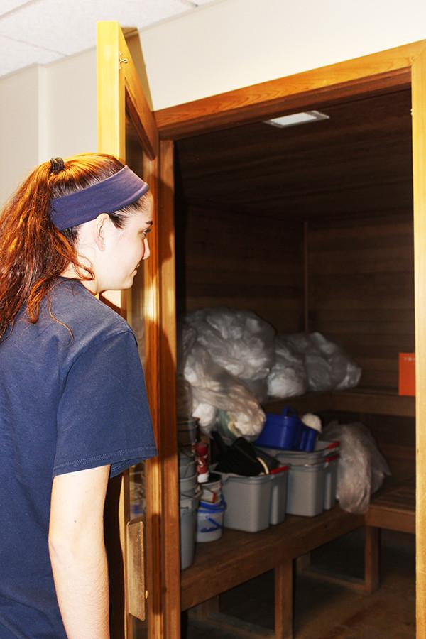 Sophomore Megan Lokaiser, a Living/Learning Center resident, peers into a room that houses a broken sauna.