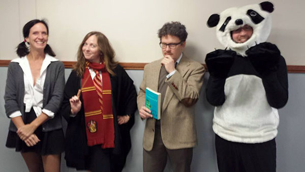 (Left to right) Catherine Cox, Marissa Landrigan, Jeremy Justus and Paul Lucas dress in their winning Halloween costumes.