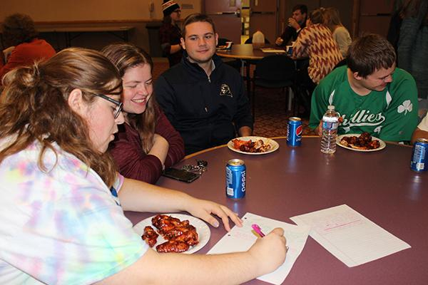 Left to right, freshmen Allura Rigoni, Kay Morris and Nick Clarke write down campus suggestions for student government members to think about at a brainstorm event.