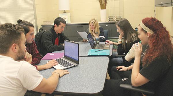 From left to right sit Vitto Marini, Jacob Williamson-Rea, Dylan Gumbel, Kristin Cafaro, Amanda Eckenrod and Alyshia Sechoka. Tutors Williamson-Rea, Cafaro and Sechoka assist students who attend a drop-in writing tutoring session in the Academic Success Center.
