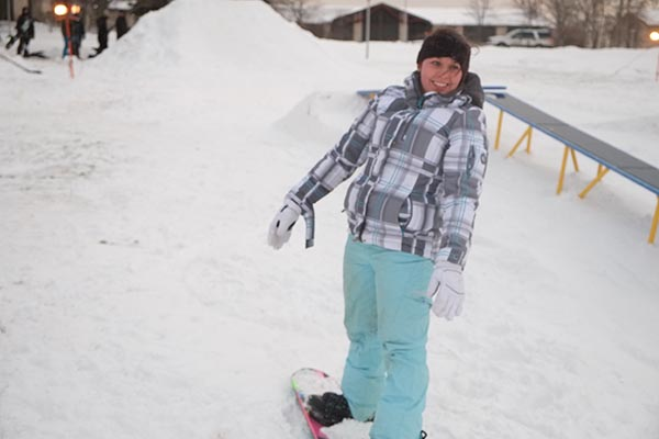 Junior Lorin Simboli participates in the Rail Jam snowboarding contest last Friday in front of the library and Campus Mall.