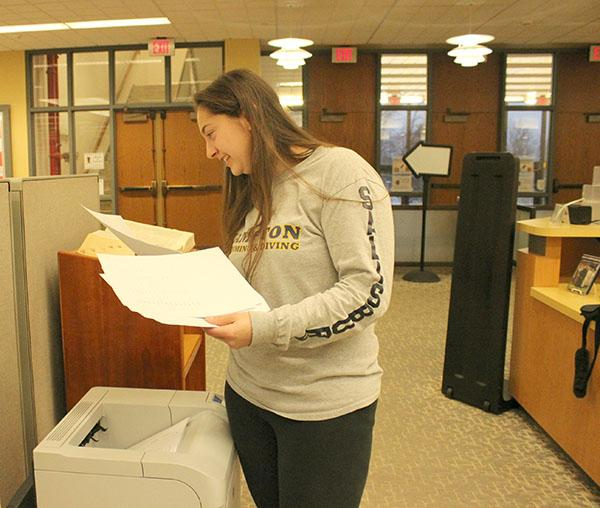 Pitt-Johnstown student Julie Salisbury prints off documents from a printer in the Owen Library.