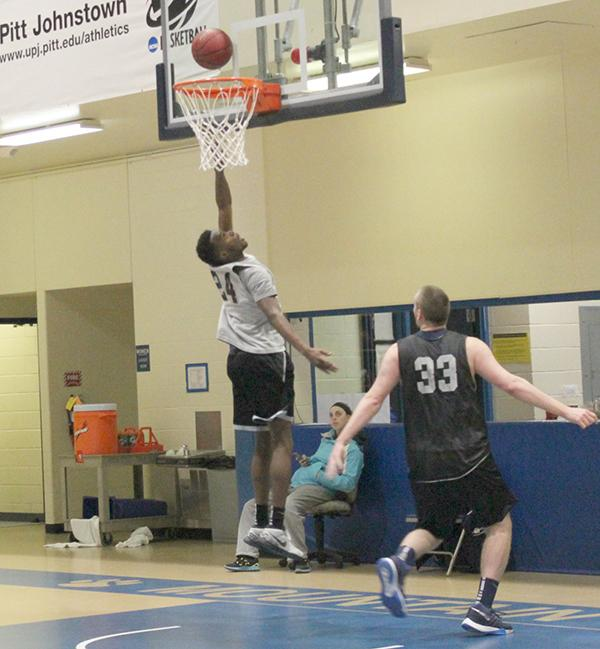 Sophomore forward Levi Masua on offense makes a layup in practice last week as junior forward A.J. Leahey defends.
