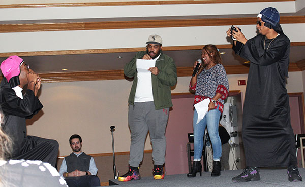From left to right are sophomore Rafiq Whitley, junior Nico Fedusa, junior Taj Green, sophomore Dana Dyer and sophomore TJ Mitchell-Scott. Volunteer Mitchell-Scott photographs volunteer Whitley as announcers Green and Dyer read information about Mitchell-Scott and Whitley to the audience.