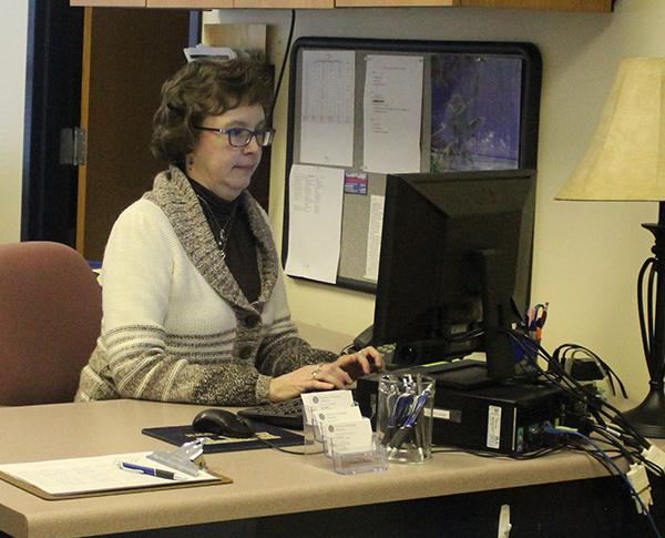 Employer relations specialist Kim Shook, a Career Services employee, types on a computer in the Career Services office.