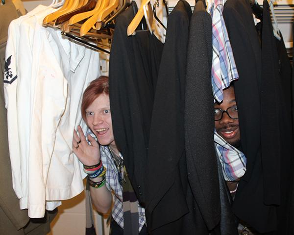 Freshman Patrick Cadden (left) and junior Demar Watson (right) hide among costumes in a dressing room at the Pasquerilla Performing Arts Center while at a play practice.