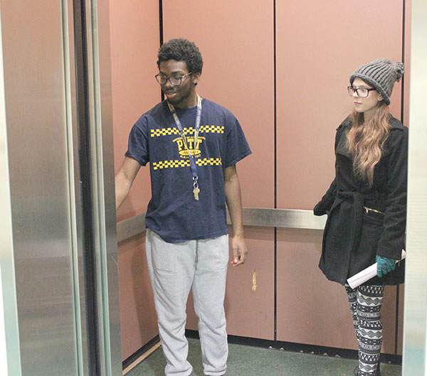 Sophomore Demar Watson (left) is in a Living/Learning Center's elevator with Freshman Kiri McCoy.