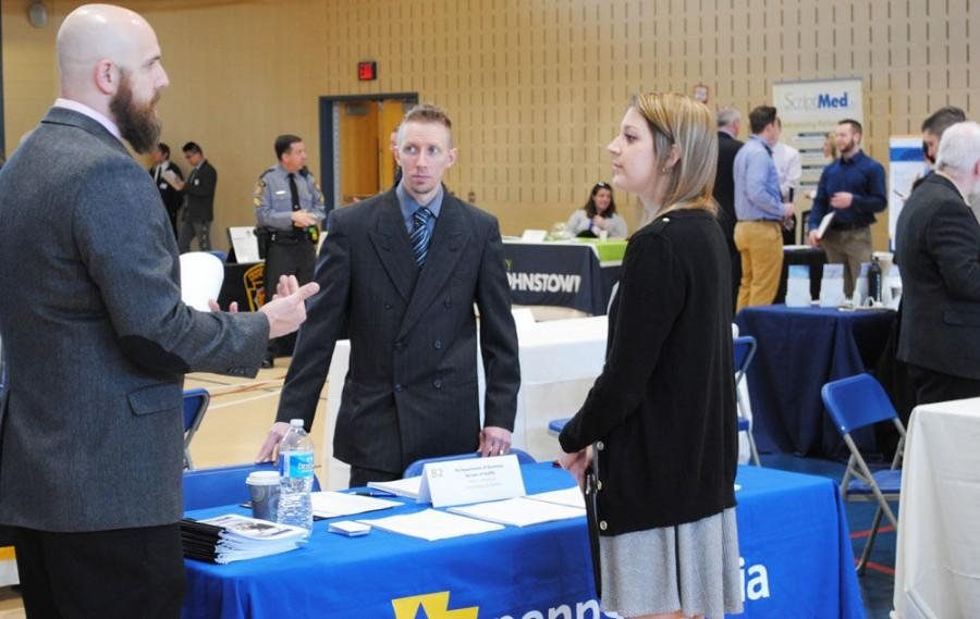 A photo from upj.pitt.edu shows students and employers talking at the job and internship fair March 24.