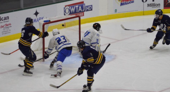 Forward Mark Swankler (right) scores a goal in the Icecats 6-5 victory Oct. 24 against Fredonia (N.Y.) State University at the Cambria County War Memorial Arena.