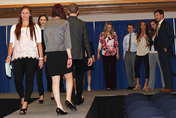 All participants walk the runway as the event ends.