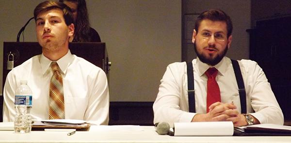 Presidential candidate Kyle Maguire (left) and vice presidential candidate Nick DiGiorgio (right) speak at a debate.