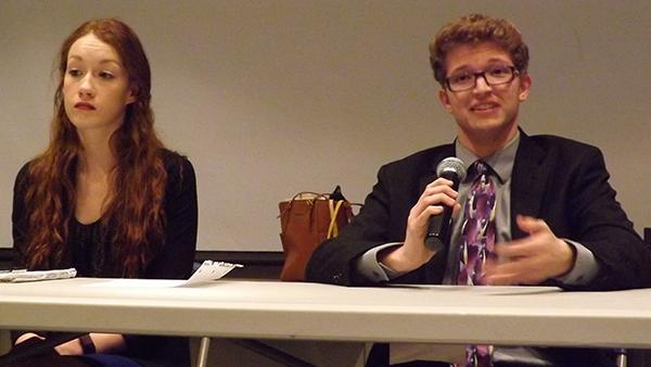 Vice presidential candidate Casey Ansbro sits next to presidential candidate Samuel Miller during a debate.