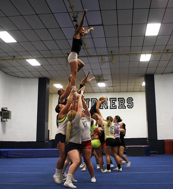 Captain flyer  Heather Rodver in the air during practice last week before leaving for Daytona to compete in nationals.