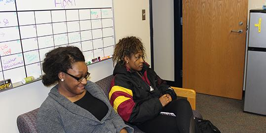 Programming Board officers Ogechi Duru (left) and Dana Dyer (right) have a discussion at the club's weekly meeting.