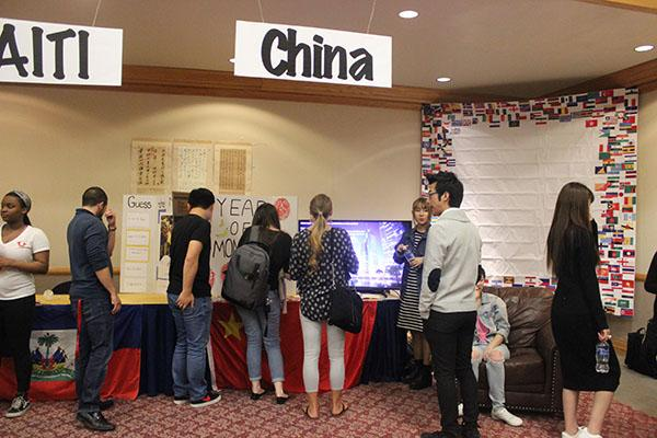 Festival attendees look at a booth about China.