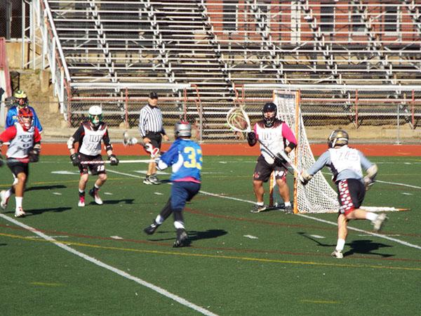 Michael Dowling making a play against an Indiana University of Pennsylvania player.