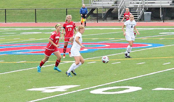 Pitt-Johnstown's Katie Bucchin passes the ball to Emily Pennell in a 2015 game against Davis & Elkins (W.Va) College.