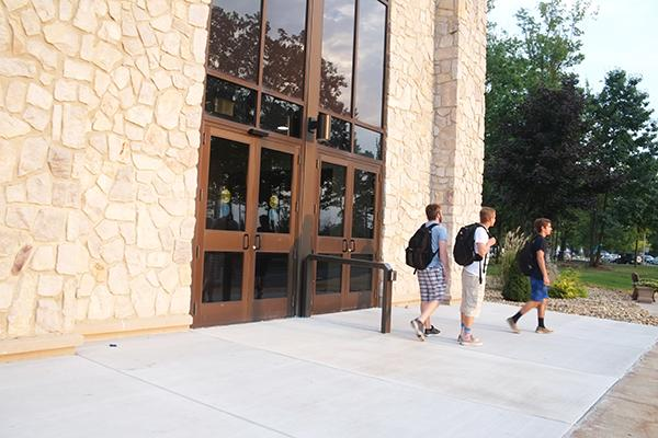 Sophomores Tony Pavia (left), Lucas Fetters (middle) and Dominic Grasso leave Blackington Hall after finding the doors locked at about 7 p.m. Sept. 17.