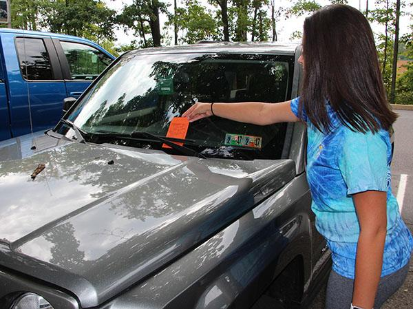 Junior Niki Kusy may pay the hidden costs of parking.