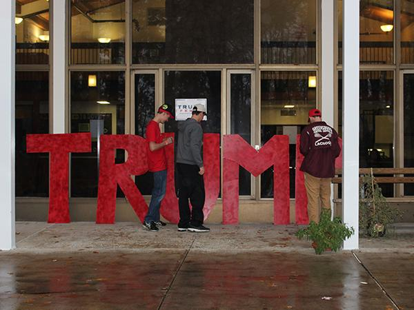 Students stand letters in front of a residence hall after attending the rally.