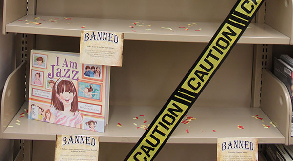 A shelf in the library is used to display some banned books.