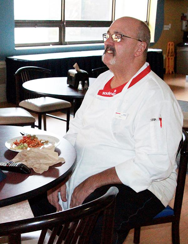 Sodexo employee Robert Wagner eats lunch alone in the Mt. Cat Club.