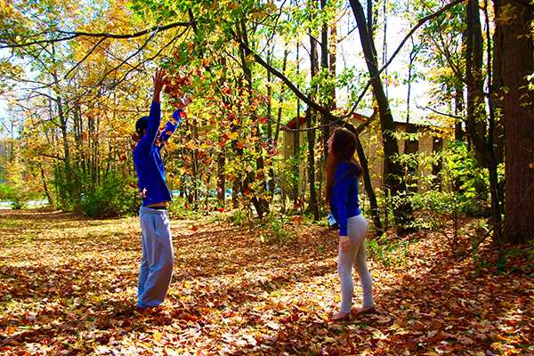 Freshmen Alex Berkhimer (left) and Veeka Needhamn enjoy campus in fall.