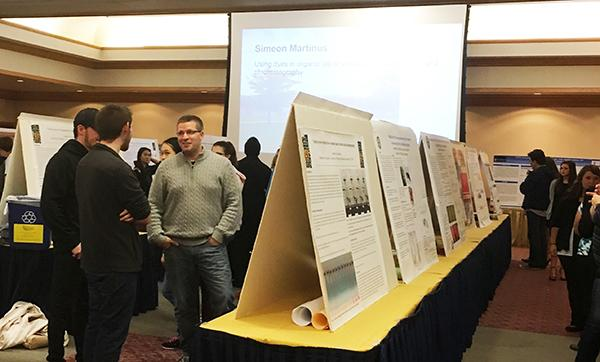 Guests tour the Cambria Room to view student and faculty research on display at the Fall into Research fair.