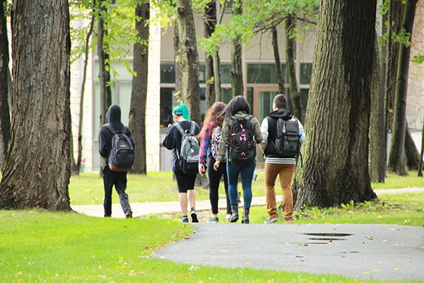 Students walk on trails between Willow Hall and Biddle Hall.