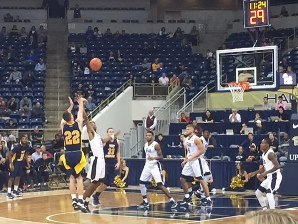 Senior guard (22) Jake Laravie takes a shot against the Pitt Panthers on Saturday at the Peterson Events Center.