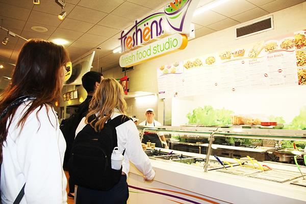 Students wait to order from Freshens, a retail-style location in the Tuck Shop.