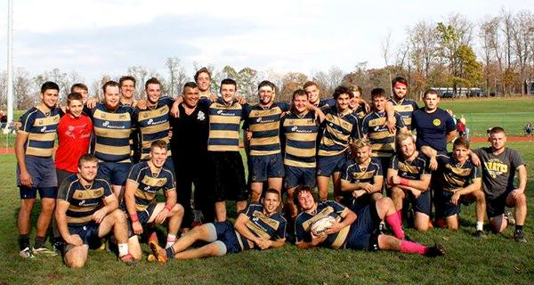 The undefeated Pitt-Johnstown rugby team poses after their 27-10 victory against Saint Francis University Saturday, ending their regular season.