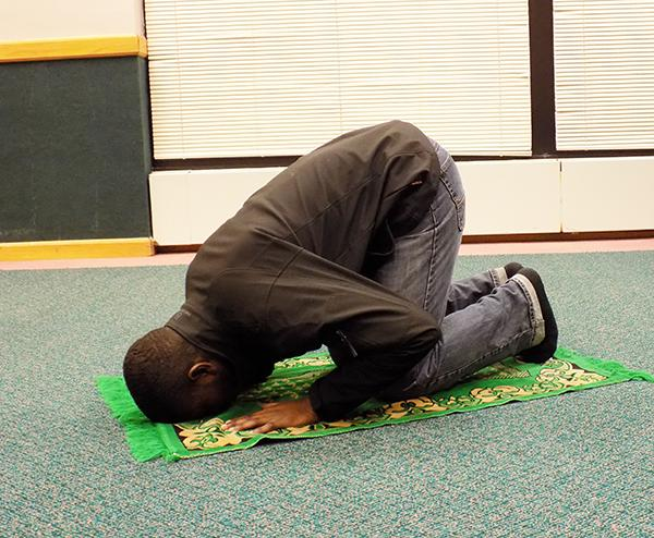 Junior Abdullahi Mada prays in the Campus Room in the Living/Learning Center.