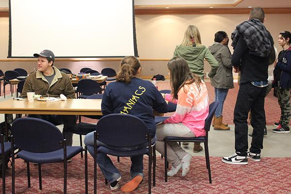 Students enjoy free food in the Student Union's Cambria Room Dec. 2 during a collaborative game night hosted by three clubs' members.