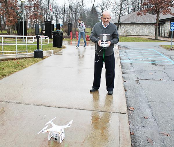 Geography professor Ahmad Massasati prepares to launch his drone Friday. Massasati and students in the Geography Department use the drones to take aerial photos of campus.