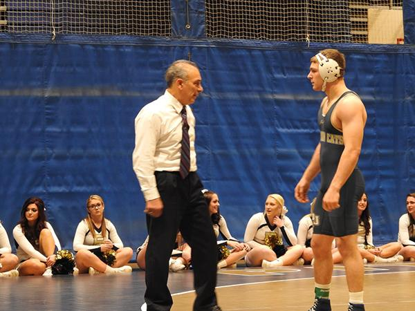Pitt-Johnstown wrestling coach Pat Pecora talks to wrestler John Blankenship during a brief intermission.
