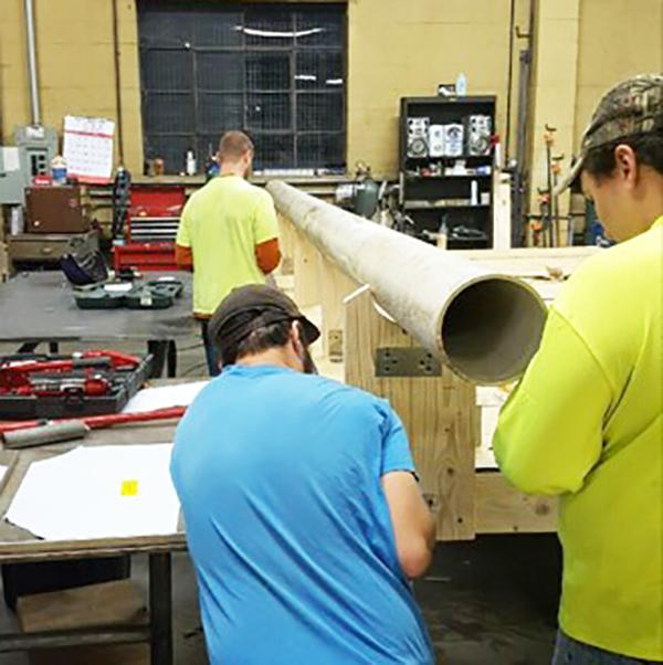 Pitt-Johnstown Ski-and-Board Club members build features for the second annual Rail Jam competition at Craft Manufacturing in Latrobe. The event is to be held Feb. 3.