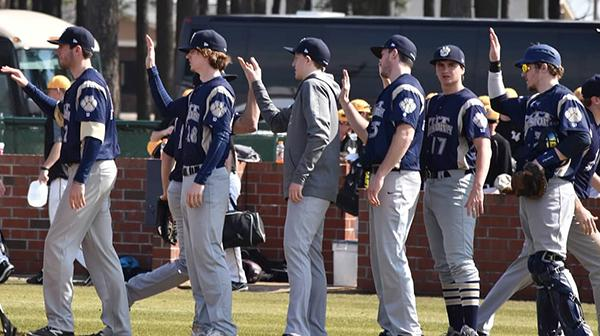 Pitt-Johnstown baseball team members celebrate a win last year over Indiana (Pa.) in Williamston, N.C.