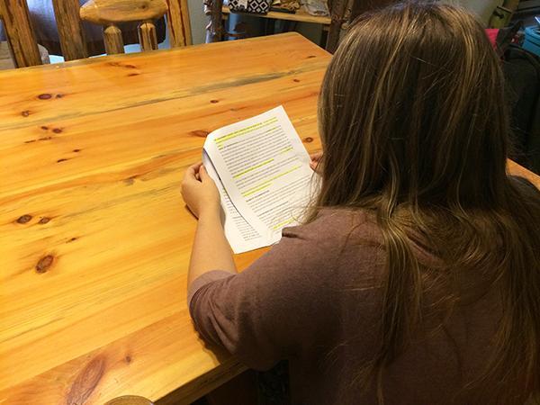 Junior Morgan Shumaker reads through homework for her Mass Communication Process course.
