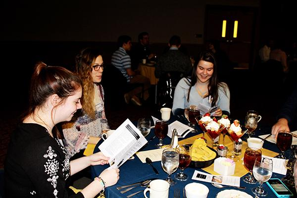 Sophomores Bryanne Baughman (left),  Samantha Albert (middle) and Abigail Witkosky (right) learn proper etiquette at a dinner Wednesday in the Cambria Room.