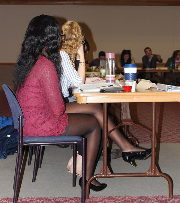 Student government members talk at the Feb. 7 meeting. It is stated in the organization's constitution that members are to dress business casual for meetings.