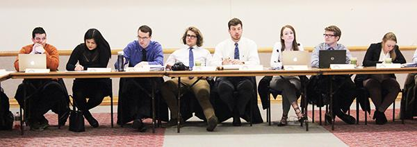 At a Feb. 21 student government meeting, executive board members listen to an emergency allocation request.