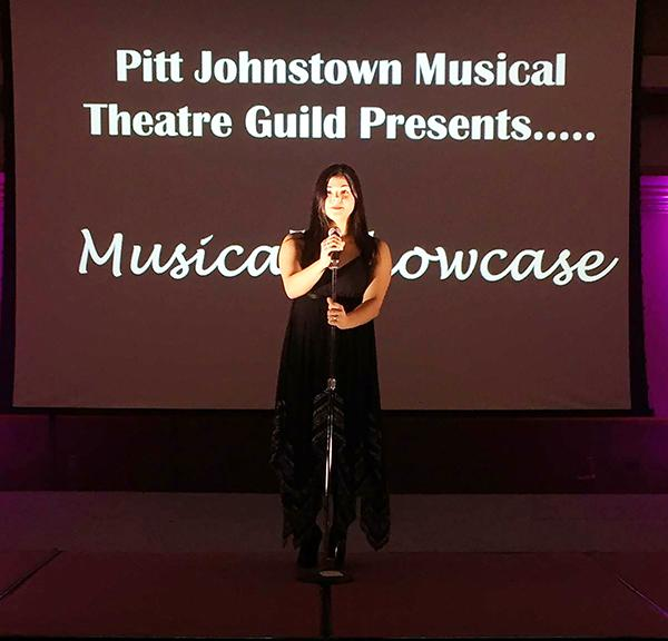 Senior Madison Nick speaks at the musical showcase Dec. 3, 2015 in the Cambria Room. | Photo: Sharon Wiant. Senior Madison Nick speaks at the musical showcase Dec. 3, 2015 in the Cambria Room.