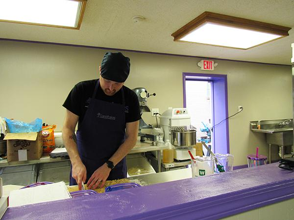 Chad Lamb, owner of the bakery Lambcakes, prepares baked goods before his store's opening Feb. 28.