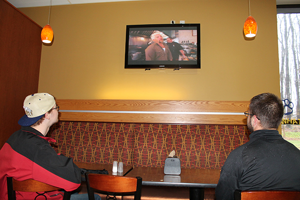 Freshman Allen Griffith and junior Mike Kawka watch the television in the Student Union.