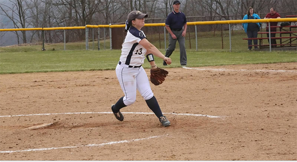 Pitt-Johnstown junior softball pitcher Emily Moore throws a pitch against Edinboro University March 25 at V.E Erickson complex.